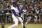Arizona Diamondbacks' Adam Jones connects for a two-run double against the Los Angeles Dodgers during the fifth inning of a baseball game Thursday, Aug. 29, 2019, in Phoenix. (AP Photo/Ross D. Franklin)