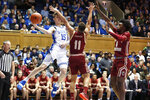Duke guard Alex O'Connell (15) passes around Boston College guard Derryck Thornton (11) and forward CJ Felder (0) during the first half of an NCAA college basketball game in Durham, N.C., Tuesday, Dec. 31, 2019. (AP Photo/Gerry Broome)