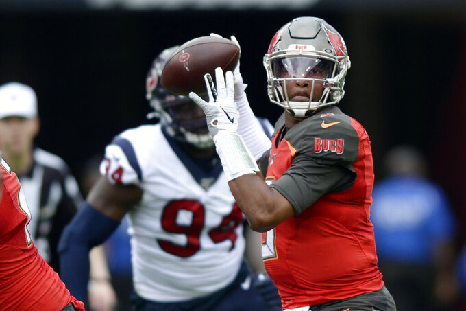 FILE - In this Dec. 21, 2019, file photo, Tampa Bay Buccaneers quarterback Jameis Winston (3) throws a pass during the first half of an NFL football game against the Houston Texans in Tampa, Fla. Winston, Cam Newton and Jadeveon Clowney didn't have to wait long at all to find homes in the NFL when they came out of college. The three former No. 1 overall draft picks are finding things moving much more slowly as they search for new homes or contracts this offseason. (AP Photo/Jason Behnken, File)