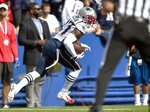 New England Patriots defensive back J.C. Jackson carries the ball after intercepting a pass by Buffalo Bills quarterback Josh Allen in the first half of an NFL football game, Sunday, Sept. 29, 2019, in Orchard Park, N.Y. (AP Photo/Adrian Kraus)