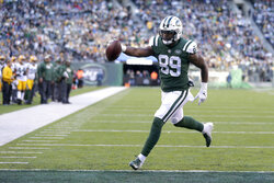 FILE - In this Dec. 23, 2018 file photo, New York Jets tight end Chris Herndon scores on a touchdown pass form quarterback Sam Darnold, not visible, during the second half of an NFL football game against the Green Bay Packers, in East Rutherford, N.J.  Herndon has a hamstring injury that will sideline him for an undetermined amount of time.  Coach Adam Gase says Wednesday, Oct. 9, 2019, the second-year tight end was injured last Friday while running routes on his own.(AP Photo/Seth Wenig, File)