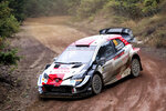 Kalle Rovanpera and his co-driver Jonne Halttunen of Finland in their Toyota Yaris WRC car, compete in the WRC Acropolis Rally at the stage of Tarzan 2, northwest of Athens, Sunday, Sept. 12, 2021. The Finnish crew of Kalle Rovanpera and Jonne Halttunen has won the Acropolis Rally, after leading through most of the four-day World Rally Championship race. (Klodian Lato/Eurokinissi via AP)