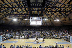 North Carolina and Wofford tipoff to start an NCAA college basketball game in historic Carmichael Arena in Chapel Hill, N.C., Sunday, Dec. 15, 2019. (AP Photo/Chris Seward)