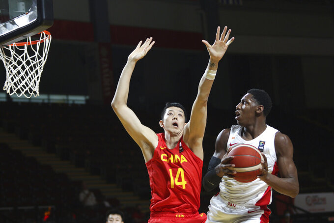Canada's RJ Barrett looks to shoot past China's Zijie Shen during the first half of a FIBA men's Olympic basketball qualifying game Wednesday, June 30, 2021, in Victoria, British Columbia. (Chad Hipolito/The Canadian Press via AP)