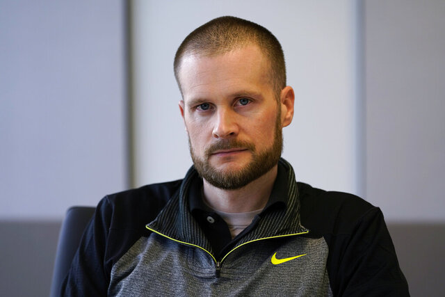 In this Dec. 31, 2020, file photo pardoned Blackwater contractor Evan Liberty poses for a photo in Washington. Liberty is one of four former Blackwater contractors pardoned by President Donald Trump in one of his final acts in office, wiping away their convictions in a 2007 shooting rampage in Baghdad that killed more than a dozen Iraqi civilians. The pardons were met with intense condemnation both in the United States and the Middle East. (AP Photo/Susan Walsh)