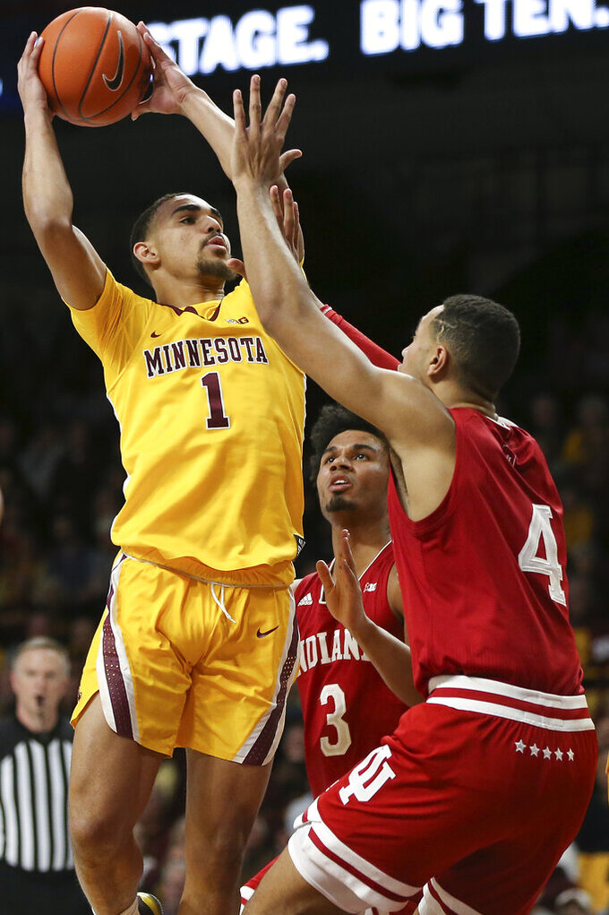 Minnesota's Tre' Williams shoots as Indiana's Trayce Jackson-Davis defends during the first half of an NCAA college basketball game Wednesday, Feb. 19, 2020, in Minneapolis. (AP Photo/Stacy Bengs)