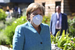German Chancellor Angela Merkel arrives at an official welcome at the G7 summit in Carbis Bay, Cornwall, England, Saturday, June 12, 2021. (Leon Neal/Pool Photo via AP)