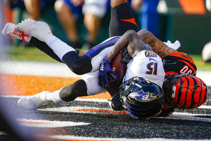 Baltimore Ravens wide receiver Marquise Brown (15) scores a touchdown against Cincinnati Bengals free safety Jessie Bates (30) during the second half of NFL football game, Sunday, Nov. 10, 2019, in Cincinnati. (AP Photo/Gary Landers)