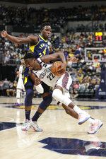 Brooklyn Nets guard Caris LeVert (22) drives against Indiana Pacers guard Victor Oladipo (4) during the second half of an NBA basketball game in Indianapolis, Monday, Feb. 10, 2020. (AP Photo/Michael Conroy)