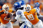 Kentucky quarterback Terry Wilson (3) is pressured by Tennessee linebacker Darrell Taylor (19) in the first half of an NCAA college football game Saturday, Nov. 10, 2018, in Knoxville, Tenn. Wilson was sacked on the play. (AP Photo/Wade Payne)