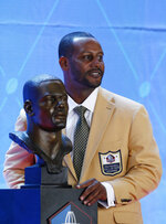 Former NFL player Ty Law poses with his Pro Football Hall of Fame bust during inductions at the hall Saturday, Aug. 3, 2019, in Canton, Ohio. (AP Photo/Ron Schwane)