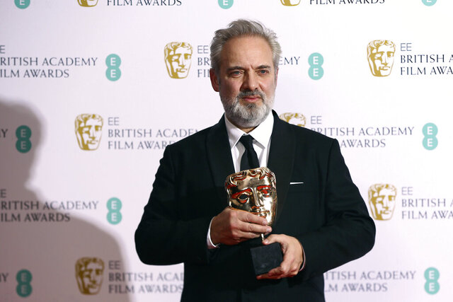Director Sam Mendes poses with the Best Director award for 1917, backstage at the Bafta Film Awards, in central London, Sunday, Feb. 2, 2020. (Photo by Joel C Ryan/Invision/AP)