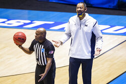 Michigan head coach Juwan Howard questions a call during the second half of a first-round game against Texas Southern in the NCAA men's college basketball tournament, Saturday, March 20, 2021, at Mackey Arena in West Lafayette, Ind.  (AP Photo/Robert Franklin)