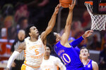 Tennessee guard Josiah-Jordan James (5) blocks a shot by Kansas forward Jalen Wilson (10) during an NCAA college basketball game in Knoxville, Tenn., Saturday, Jan. 30, 2021. (Caitie McMekin/Knoxville News Sentinel via AP, Pool)
