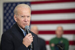 Democratic presidential candidate former Vice President Joe Biden greets supporters as he arrives for a campaign event, Saturday, Jan. 25, 2020, at the Mary A. Fisk Elementary School in Salem, N.H. (AP Photo/Mary Altaffer)