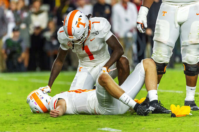 Tennessee wide receiver Marquez Callaway (1) checks on quarterback Brian Maurer (18) who was hurt on the play against Alabama during the first half of an NCAA college football game, Saturday, Oct. 19, 2019, in Tuscaloosa, Ala. (AP Photo/Vasha Hunt)