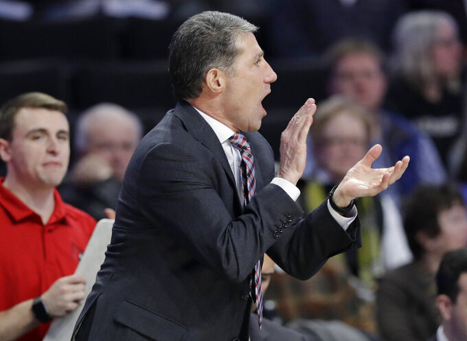 Louisville assistant coach Dino Gaudio cheers on his team against Wake Forest during the second half of an NCAA college basketball game in Winston-Salem, N.C., Wednesday, Jan. 30, 2019. (AP Photo/Chuck Burton)