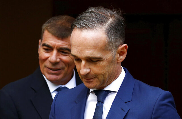 German Foreign Minister Heiko Maas, right, and Israeli Foreign Minister Gabi Ashkenazi arrive to a news conference in front of the Liebermann Villa at the Wannsee lake in Berlin, Germany, August 27, 2020. (Michele Tantussi/Pool Photo via AP)