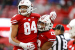 Wisconsin tight end Jake Ferguson (84) and running back Jonathan Taylor celebrate Tylor's touchdown against Kent State during the first half of an NCAA college football game Saturday, Oct. 5, 2019, in Madison, Wis. (AP Photo/Andy Manis)