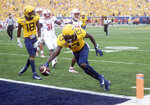 West Virginia wide receiver Sam James (13) scores the Mountaineers' first touchdown during the first half of  an NCAA college football game against N.C. State on Saturday, Sept. 14, 2019, in Morgantown, W. Va. (Stephanie Panny/Times-West Virginian via AP)