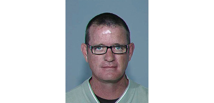 This undated photo provided by the Maricopa County Sheriff's Office shows Stephen Douglas Gore, the owner of a now-closed Phoenix body donation facility who in 2015 pleaded guilty to a felony charge for his role in mishandling donations of human remains. Jury deliberations have entered their fifth day Tuesday, Nov. 19, 2019 at a trial to determine whether Gore is civilly liable for mishandling donated human remains. (Maricopa County Sheriff's Office via AP, file)