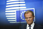 European Council President Donald Tusk listens to questions during a media conference at the conclusion of an EU summit in Brussels, Friday, March 22, 2019. European Union leaders gathered again Friday after deciding that the political crisis in Britain over Brexit poses too great a threat and that action is needed to protect the smooth running of the world's biggest trading bloc. (AP Photo/Francisco Seco)