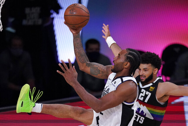 Los Angeles Clippers' Kawhi Leonard (2) shoots against Denver Nuggets' Jamal Murray (27) during the second half of an NBA conference semifinal playoff basketball game, Wednesday, Sept. 9, 2020, in Lake Buena Vista, Fla. (AP Photo/Mark J. Terrill)