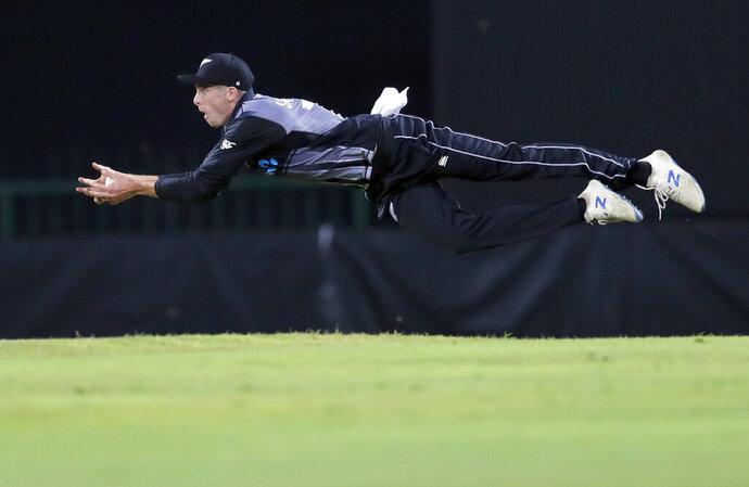 In this Tuesday, Sept. 3, 2019, file photo, New Zealand's Mitchell Santner successfully takes a catch to dismiss Sri Lanka's Avishka Fernando during the second Twenty20 international cricket match between Sri Lanka and New Zealand in Pallekele, Sri Lanka. (AP Photo/Eranga Jayawardena, File)
