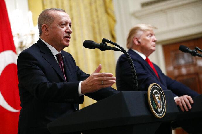 Turkish President Recep Tayyip Erdogan speaks at a news conference alongside President Donald Trump in the East Room of the White House, Wednesday, Nov. 13, 2019, in Washington. (AP Photo/Patrick Semansky)