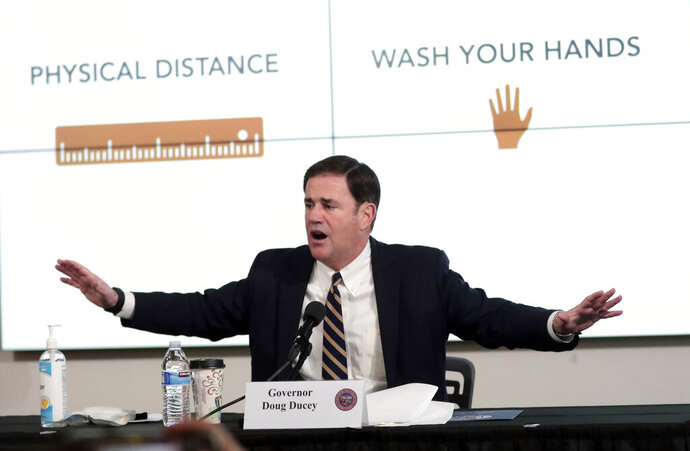 Gov. Doug Ducey updates reporters on the coronavirus pandemic during a news conference in Phoenix, Monday, June 29, 2020. (Michael Chow/The Arizona Republic via AP, Pool)