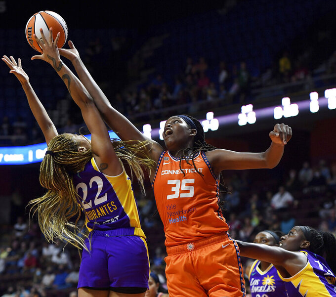 Connecticut Sun forward Jonquel Jones tips a rebound away from Los Angeles Sparks guard Arella Guirantes (22) during a WNBA basketball game Thursday, Aug. 26, 2021, in Uncasville, Conn. (Sean D. Elliot/The Day via AP)