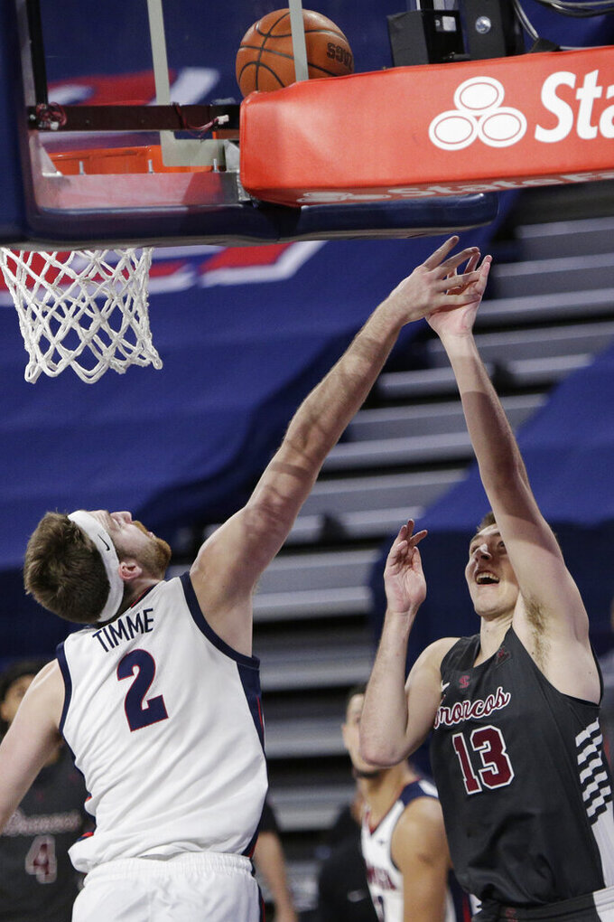 Santa Clara forward Josip Vrankic (13) shoots over Gonzaga forward Drew Timme (2) during the second half of an NCAA college basketball game in Spokane, Wash., Thursday, Feb. 25, 2021. (AP Photo/Young Kwak)