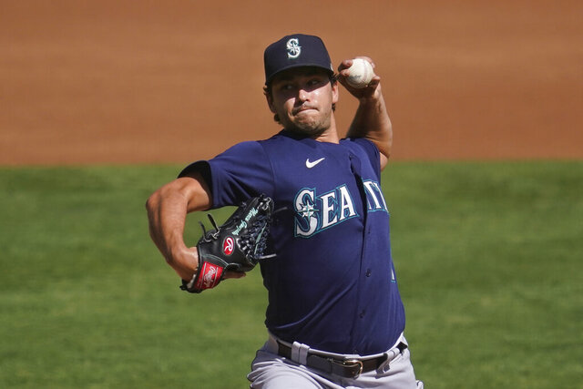 Seattle Mariners' Marco Gonzales pitches against the Oakland Athletics during the first inning of a baseball game in Oakland, Calif., Sunday, Sept. 27, 2020. (AP Photo/Jeff Chiu)