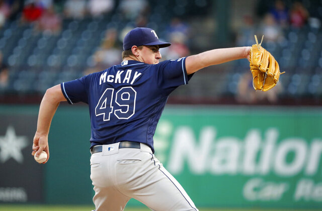 FILE - In this Sept. 12, 2019, file photo, Tampa Bay Rays starting pitcher Brendan McKay throws to a Texas Rangers batter during a baseball game in Arlington, Texas. McKay will have season-ending surgery on his left throwing shoulder Wednesday, Aug. 19. The 24-year-old McKay tested positive for the coronavirus in early July and missed most of the club's preseason camp. He was cleared to resume activities July 31 and reported to the club's alternate site, but then experienced stiffness in his pitching shoulder and was shut down last week. (AP Photo/Tony Gutierrez, File)