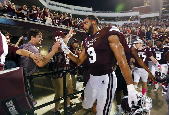 FILE - In this Saturday, Oct. 6 2018, file photo, Mississippi State defensive end Montez Sweat (9) celebrates with fans following the team's NCAA college football game against Auburn in Starkville, Miss. No. 24 Mississippi State has some problems to fix during its off week, but they're mostly on the offensive end. The Bulldogs' defense has been elite and is giving up just 12.7 points per game, which ranks No. 1 in the country. (AP Photo/Rogelio V. Solis, File)