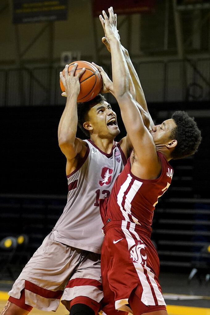 Stanford forward Oscar da Silva (13) shoots against Washington State center Dishon Jackson during the second half of an NCAA college basketball game in Santa Cruz, Calif., Saturday, Jan. 9, 2021. (AP Photo/Jeff Chiu)