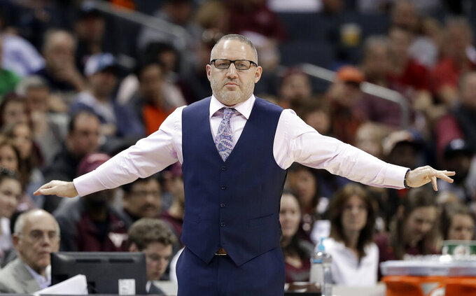 Virginia Tech head coach Buzz Williams directs his team against Miami during the second half of an NCAA college basketball game in the Atlantic Coast Conference tournament in Charlotte, N.C., Wednesday, March 13, 2019. (AP Photo/Chuck Burton)