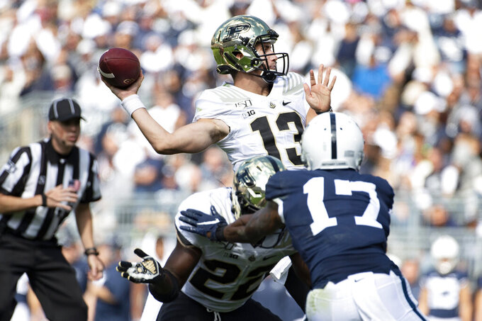 Purdue quarterback Jack Plummer (13) throws a 15-yard touchdown pass to wide receiver Amad Anderson Jr. (10) in the second quarter of an NCAA college football game against Penn State in State College, Pa., on Saturday, Oct. 5, 2019. (AP Photo/Barry Reeger)