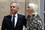 Outgoing Ecology Minister Francois de Rugy and his wife Severine Servat de Rugy attend the handover ceremony at the ecology ministry, Wednesday, July 17, 2019 in Paris. Francois de Rugy resigned Tuesday following media reports that he has been living a lavish lifestyle at taxpayer expense, including hosting lobster and Champagne soirees and ordering up exorbitant renovations of his ministerial apartment. (AP Photo/Kamil Zihnioglu)