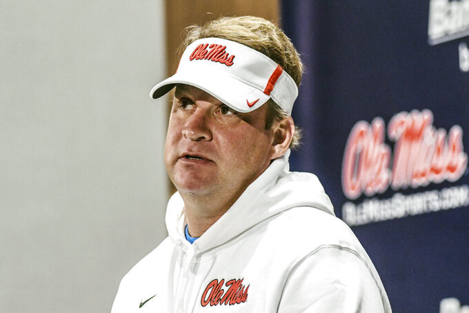 FILE - In this Dec. 18, 2019, file photo, Mississippi head coach Lane Kiffin discusses the team's signing class during a press conference at the Manning Center in Oxford, Miss. The coronavirus pandemic has shut down much of Division I football, but with three of the Power Five leagues still playing, there are still some big games to look forward to. Mississippi will verse Mississippi State on Nov. 28, 2020.  (Bruce Newman/The Oxford Eagle via AP, File)