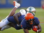 Illinois's Reggie Corbin, front, is tackled by South Florida's Ronnie Hoggins during the second half of an NCAA college football game Saturday, Sept. 15, 2018, in Chicago. (AP Photo/Jim Young)