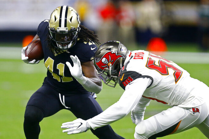 New Orleans Saints running back Alvin Kamara (41) carries against Tampa Bay Buccaneers outside linebacker Lavonte David (54) in the first half of an NFL football game in New Orleans, Sunday, Oct. 6, 2019. (AP Photo/Butch Dill)