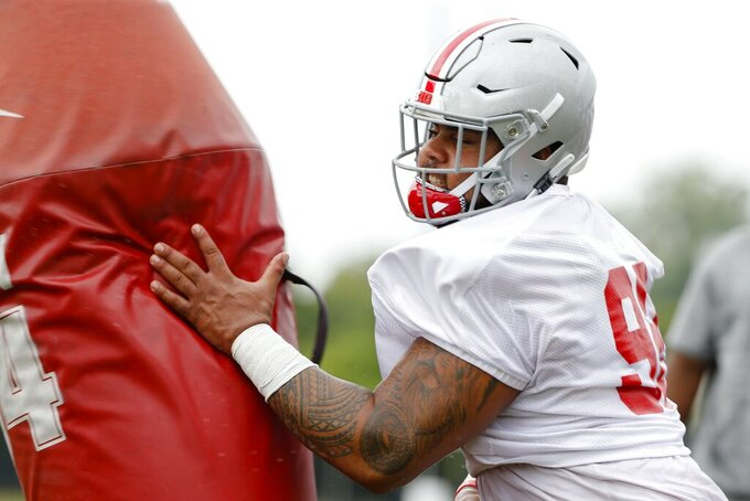 Ohio State Buckeyes defensive tackle Haskell Garrett runs a drill during Ohio State Buckeyes football practice on Wednesday, Aug. 14, 2019, at the Woody Hayes Athletic Center in Columbus, Ohio. Garrett is expected to be released from the hospital after being shot in the face over the weekend, coach Ryan Day said. Day said in a statement that Garrett, who was hit by a bullet that passed through both of his cheeks, was expected to be released Monday. (Joshua A. Bickel/The Columbus Dispatch via AP)