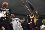 Connecticut's Christian Vital, left, shoots over Iona's Tajuan Agee in the first half of an NCAA college basketball game, Wednesday, Dec. 4, 2019, in Storrs, Conn. (AP Photo/Jessica Hill)