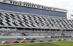 Brad Keselowski (2) leads a field of cars out of the front stretch during a practice session for the NASCAR Daytona 500 auto race at Daytona International Speedway, Friday, Feb. 15, 2019, in Daytona Beach, Fla. (AP Photo/John Raoux)