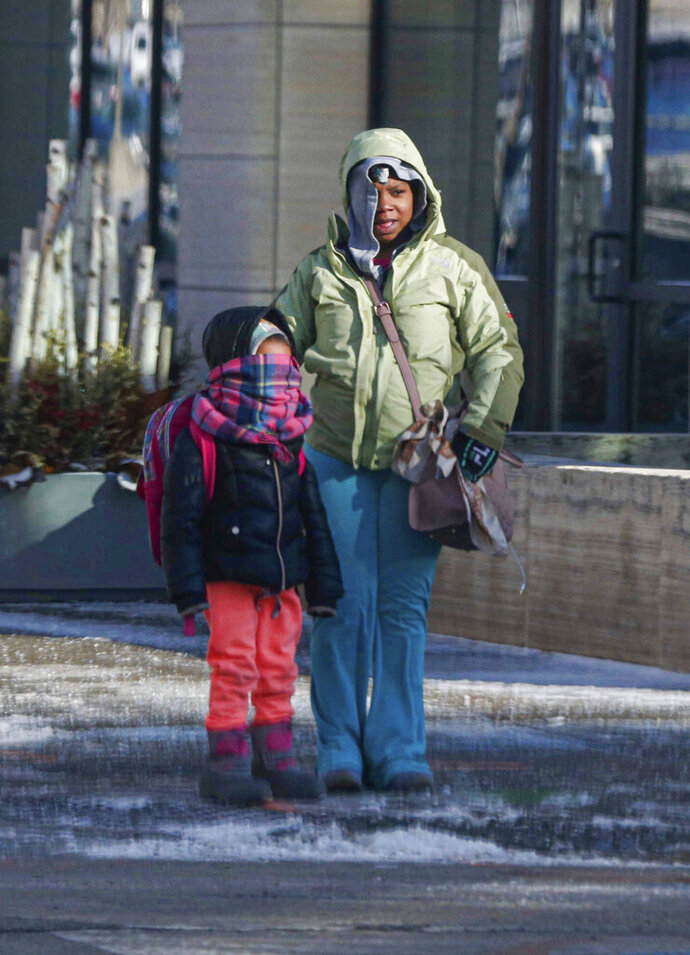 Pedestrians bundle up as they face sub-zero temperatures in Des Moines on Thursday, Feb. 13, 2020. The freeze won't last long, however, the temperature in central Iowa will reach the 40s by this weekend. (Bryon Houlgrave/The Des Moines Register via AP)