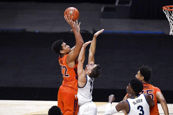 Virginia Tech's Keve Aluma shoots as Villanova's Collin Gillespie defends during the first half of an NCAA college basketball game Saturday, Nov. 28, 2020, in Uncasville, Conn. (AP Photo/Jessica Hill)