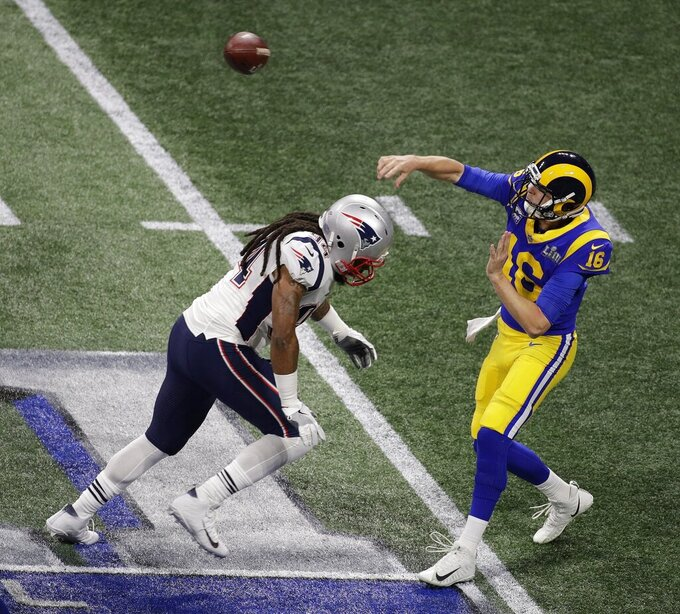Los Angeles Rams' Jared Goff (16) works under pressure from New England Patriots' Adrian Clayborn (94) during the first half of the NFL Super Bowl 53 football game Sunday, Feb. 3, 2019, in Atlanta. (AP Photo/Charlie Riedel)