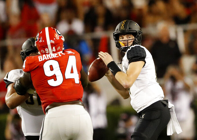 Vanderbilt quarterback Kyle Shurmur (14) drops back to pass during the first half of the team's NCAA college football game against Georgia Saturday, Oct. 6, 2018, in Atlanta. (AP Photo/John Bazemore)