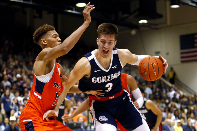 Gonzaga forward Filip Petrusev (3) drives against Pepperdine forward Kessler Edwards (15) during the second half of an NCAA college basketball game Saturday, Feb. 15, 2020, in Malibu, Calif. Pepperdine won 89-77. (AP Photo/Ringo H.W. Chiu)